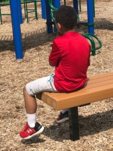 Foster child at park