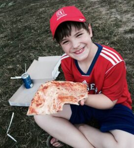 Foster Child eating pizza